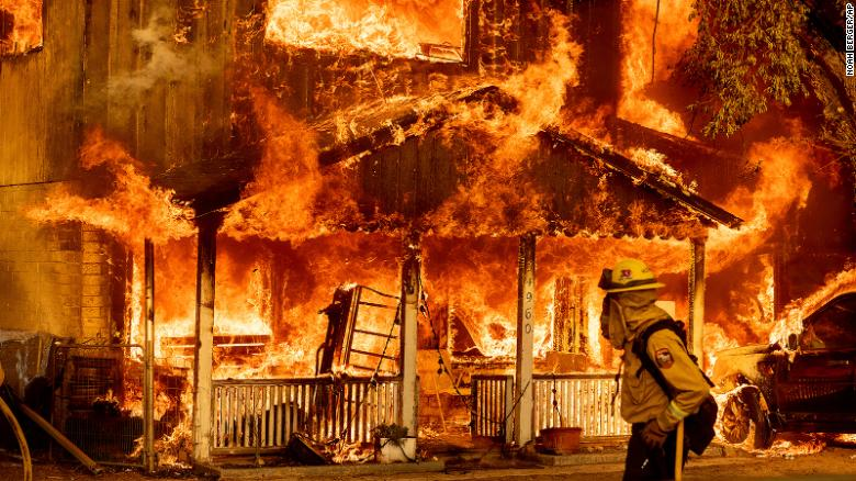 Fire consumes a home as the Sugar Fire, part of the Beckwourth Complex Fire, tears through Doyle, California, on Saturday, July 10, 2021.