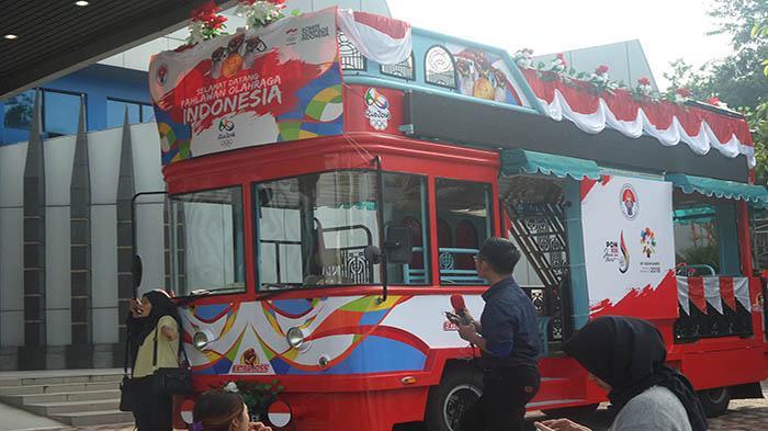 Arak-arakan Tontowi/Liliyana Dilakukan Dua Kali Dengan Bus Bandros